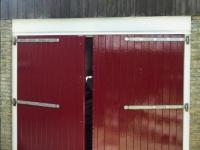 Garagedeuren gerepareerd / geschilderd